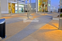 The racetrack infield at the nearby Daytona International Speedway was the inspiration for this unique decorative concrete paving that was created using Bomanite Integral Color with two-tone coloration, which will provide longevity and durability of color.