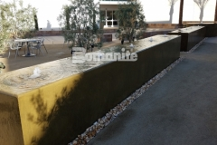 We formed the walls of this water fountain using Bomanite integrally colored concrete and a smooth trowel finish to create a beautiful, therapeutic, and soothing water feature at Clovis Community Medical Center.
