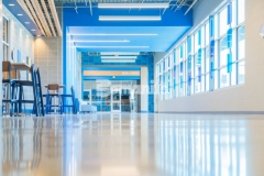 The Bomanite Modena SL Custom Polishing System was utilized at Grain Valley High School to salvage a previously damaged and abused concrete floor and the grinding and polishing process resulted in a beautifully designed, environmentally friendly, and functional flooring finish that saved the school district money and time.