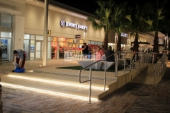 This decorative concrete step plaza and handicap ramp were created using Bomanite Alloy and the seashell exposed aggregate provides a distinct and durable finish that is a beautiful complement to the beach-industrial aesthetic styling at the Tanger Outlets in Daytona Beach, FL.