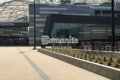 Bomanite Alloy decorative concrete with inclusions of clear glass and reflective mirror flakes was combined with Bomanite Sandscape Texture to create the walkways at LAFC Stadium and these contrasting bands add beautiful, sophisticated detail to the hardscape.