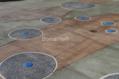 This installation by Heritage Bomanite of Bomanite Revealed concrete at Citrus Heights Community Center by Heritage Bomanite has a Sandscape finish, which makes it non-slip. The circles are seeded with recycled glass and form a fountain.