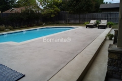 Bomanite Sandscape Refined concrete on a residential pool deck. Sandscape is non-slip and beautiful decorative concrete.