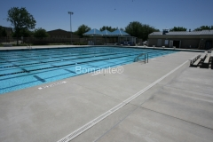 Bomanite Sandscape Texture concrete at Central East HS Pool Complex was chosen because of its durability and non-slip finish by Heritage Bomanite.