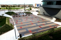 Sandscape Texture decorative concrete by Bomanite was chosen for this outdoor gathering space to provide a durable hardscape surface that is visually appealing while creating a cohesive design feel.