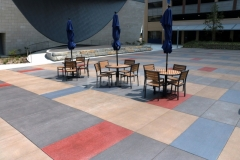 Featured here is Bomanite Sandscape Texture decorative concrete that was installed with a detailed stain pattern that complements the surrounding architecture and creates visual continuity throughout the space.