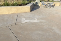 This outdoor gathering space features Bomanite Sandscape Refined Antico decorative concrete and adds beautiful variation in texture to create a distinctively beautiful hardscape.