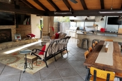 We incorporated the Bomanite Exposed Aggregate Antico process here to provide a durable concrete hardscape with a beautiful decorative treatment, creating separation between gathering areas while adding in cozy niches that are perfect for entertainment and relaxation.