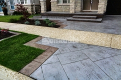 This Bomanite Yorkshire Stone imprinted concrete driveway and patio contain Bomanite Shale Gray Color Hardener and a Gray Release Agent and this beautiful combination integrates perfectly with the existing concrete walkway while adding distinctive design detail that enhances the home's architecture.
