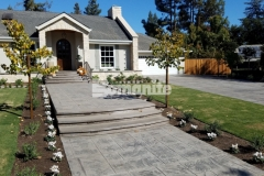 We utilized Bomanite Imprint Systems to create this stamped concrete driveway and walkway and the Bomacron English Sidewalk Slate imprint pattern that runs the length of the driveway and front entryway was the perfect choice to accentuate the European flair of this Fresno, California home.