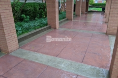 Featured here is Bomanite Bomacron Slate Texture imprinted concrete that was installed using Bomanite Cafe Au Lait Integral Color for the sidewalk bands and Bomanite Franciscan Red Color Hardener for the main expanse of the walkway to correspond with the existing brick exterior colors and provide a stylish transition at the main entrance to the Residence Condominiums.