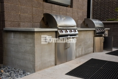 COLAB Co-Housing is a stylish living community with beautiful decorative features, including this board-formed outdoor kitchen grill that features an imprinted wood grain image on the finished face, and provides residents with the perfect place to enjoy a neighborhood cookout.
