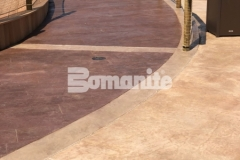 Bomanite imprinted concrete was installed here to create this stunning hardscape surface, featuring the Bomanite Bomacron Boardwalk pattern that resembles wood planking and adds beautiful design detail to this outdoor space.