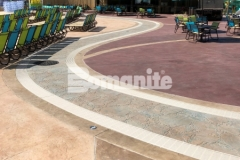 This beautiful pool decking features Bomanite Imprint Systems with multiple Bomacron patterns that were stamped into the concrete including Garden Stone, Boardwalk, Sandstone Texture, and Slate Texture and the combination of texture, color, and pattern adds distinctive design detail to the hardscape surface.