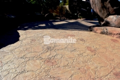 Bomanite imprinted concrete was installed here to create a decorative hardscape surface with distinct detail from the Bomacron Garden Stone pattern and durability and protection against the outdoor elements from the Autumn Brown and Forest Brown Color Hardeners and Bomanite Clear Sealer.