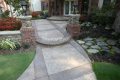 Heritage Bomanite skillfully installed this Bomanite Imprinted concrete courtyard area, creating the perfect mix of color, texture, and pattern to add a beautiful, sophisticated flair to the entry of this home.