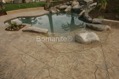 Bomanite Bomacron Textured and Pattern Imprinted Concrete pool deck by Heritage Bomanite.
