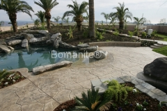Bomanite Bomacron Textured and Pattern Imprinted Concrete pool deck makes this residence feel like an oasis by Heritage Bomanite.