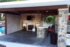 Bomanite imprinted concrete was installed here using an integral gray color for the base, stamped with the Bomacron Slate Texture pattern, and then antiqued and color washed in a darker gray to create this distinctive cabana flooring.