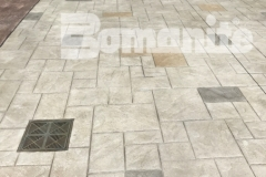 Bomanite stamped concrete was installed here to create this decorative hardscape surface and features the Bomacron Ashlar Slate pattern that is bordered by an integrally colored gray band for a beautifully distinctive combination of color, pattern, and texture.