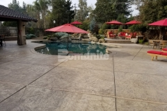 We created this expansive backyard pool deck and patio of 2,200 square feet and we stamped the cast-in-place concrete with the Bomacron Slate Texture imprint pattern, utilizing Bomanite Sand Color Hardener with Bomanite Light Brown Release Agent to enhance the natural aesthetic in this backyard oasis.