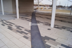 The Bomanite Sandstone pattern was utilized here to create stamped concrete accent borders in this pavilion area at Redbud Festival Park in Owasso, Oklahoma, adding definition around the concrete pavers and complementing the other design features.