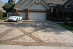 Heritage Bomanite expertly installed this Bomanite Bomacron imprinted concrete driveway with alternating bands of concrete and texture incorporated into the design,  minimizing the sight of the control joints and adding a distinctive look to this home.