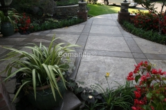 Heritage Bomanite used Bomanite Imprinted Concrete to create this beautiful courtyard and entryway, using alternating bands and colors to add visual interest and character to the exterior of this home.