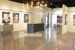 The Bomanite Patene Teres Custom Polishing System was used here to create a decorative concrete flooring surface that emanates warmth and sophistication to complement the exquisite gallery of portraits created by professional artist, Phil Taylor, as part of The American Fallen Soldiers Project.