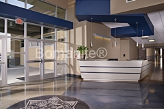 Heritage Bomanite used Bomanite Patene Teres custom polished concrete to create the perfect match for the clean lines and angular design in this entry way to the Fresno Police Department, adding the perfect blend of colors and angular saw cuts to mirror the interior design.