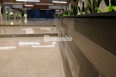 The Bomanite Renaissance Deep Grind System was installed here by our associate Musselman & Hall Contractors and includes a custom mix of individually sourced aggregates, sands, and integral colors, and this sustainable, low maintenance topping and polishing option was perfect to provide custom polished concrete flooring at Olathe West High School.