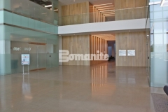 The Bomanite VitraFlor Custom Polishing System is featured here with a 1,500 grit polish and beautiful salt and pepper finish that exudes warmth and sophistication to complement the modern aesthetic of the architecture at the Cypress Waters Business Complex.