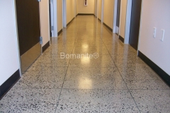 Bomanite Custom Polishing VitraFlor concrete in hallway in New Orleans.