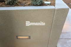 A Bomanite Micro-Top ST decorative concrete overlay was installed here to create a beautiful sand-finish texture that is durable and adds a beautiful and distinctive design aesthetic to these planter walls and planter boxes.