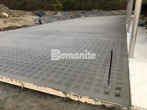 A wide view of the Grasscrete Pervious Concrete Project before the voids are created by a crew using the Punch Tool.