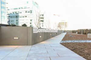 Long expansive street view of planter walls at The Coloradan at Denver Union Station using Bomanite Toppings Systems with Bomanite Micro-Top ST.