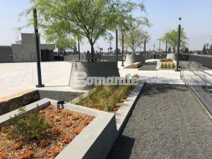 VIP Upper Deck Lounge and planters at Banc of Calif LAFC Stadium using Bomanite Sandscape Texture 4.5 foot for the Tree Planters and Shrub planters and the Deck Flooring is Precast Pavers.