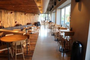 Long view of seating, windows, and decorative concrete flooring using Bomanite Custom Polishing Systems with Modena SL at the Brookside Starbucks in Kansas City.