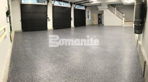 Bomanite Toppings Systems using Bomanite Broadcast Flake in one of the two garages of an Award Winning Project of decorative concrete at an Essex county estate.