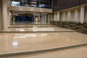 Long view of hallway steps using the Bomanite Renaissance Polished Concrete System at Olathe West High School located in Olathe, KS, and installed by Musselman & Hall Contractors.